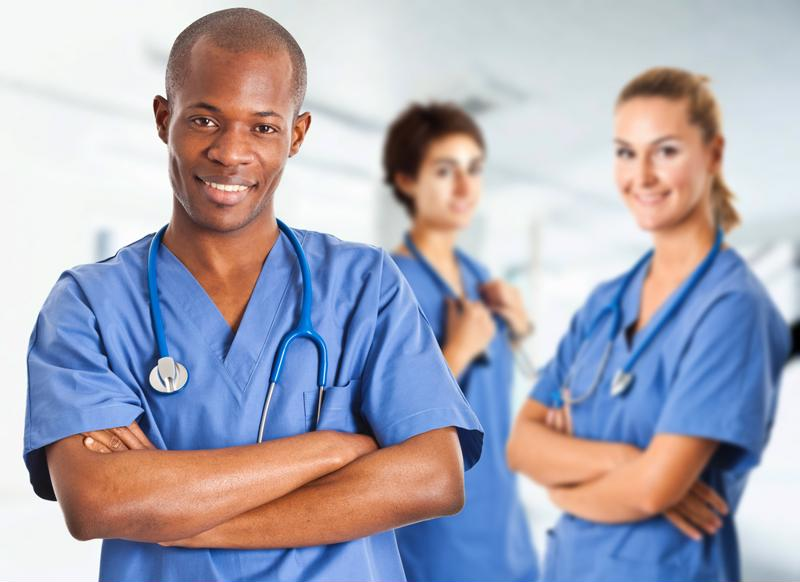 People of different genders/races in scrubs and stethoscopes.