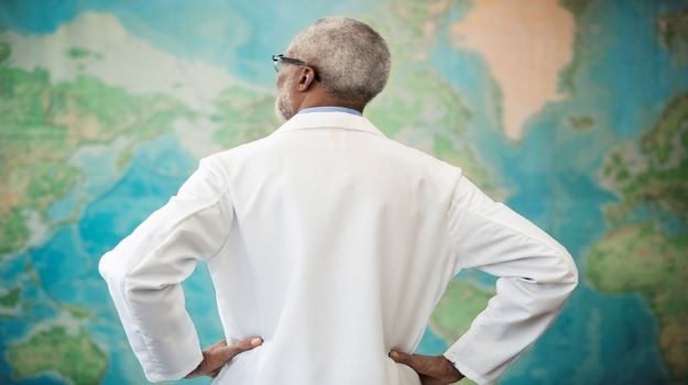 Doctor looking at map